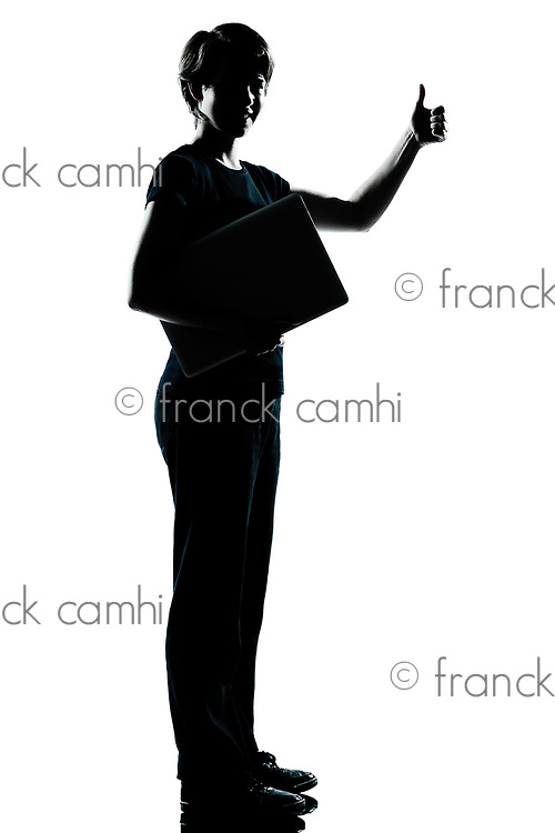 one caucasian young teenager silhouette boy  girl holding carrying laptop computer thumb up full length in studio cut out isolated on white background