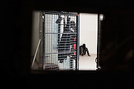 Libia, Tripoli: African migrant is seen inside his cell through the hole of an iron door at Abu Salim detention center for illegal migrants. Alessio Romenzi
