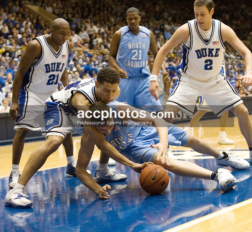 Feb. 07, 2007; Durham, NC, USA; Duke Blue Devils forward David McClure (14) and North Carolina Tar Heels forward (50) Tyler Hansbrough battle for possession at Cameron Indoor Stadium in Durham, NC.