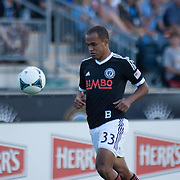 Philadelphia Union Defender FABIO ALVES (33) dribbles the ball in front of him in the first half a MLS regular season international friendly match against Stoke City F.C. Tuesday, July. 30, 2013 at PPL Park in Chester PA.