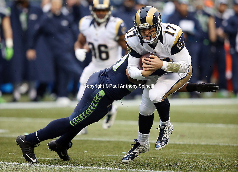 St. Louis Rams quarterback Case Keenum (17) gets tackled by Seattle Seahawks middle linebacker Bobby Wagner (54) on a third down play that comes up short of the first down marker in the first quarter during the 2015 NFL week 16 regular season football game against the Seattle Seahawks on Sunday, Dec. 27, 2015 in Seattle. The Rams won the game 23-17. (©Paul Anthony Spinelli)