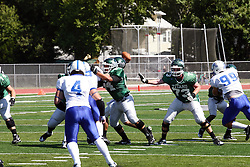 17 September 2011: Matt Siegert fills a gap in the line during an NCAA Division 3 football game between the Aurora Spartans and the Illinois Wesleyan Titans on Wilder Field inside Tucci Stadium in.Bloomington Illinois.