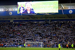 LEICESTER, ENGLAND - Saturday, November 10, 2018: Leicester City supporters hold up scarves as the club pays tribute to chairman Vichai Srivaddhanaprabha, who died in a helicopter crash on Oct 27, during the FA Premier League match between Leicester City FC and Burnley FC at the King Power Stadium. (Pic by David Rawcliffe/Propaganda)
