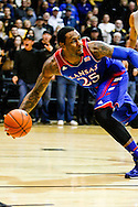 December 7th, 2013:  Kansas Jayhawks senior forward Tarik Black (25) dives to save the ball from going out of bounds in the first half of action in the NCAA Basketball game between the Kansas Jayhawks and the University of Colorado Buffaloes at the Coors Events Center in Boulder, Colorado