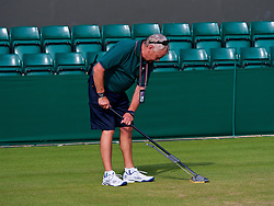 LONDON, ENGLAND - Monday, July 9, 2018: The Ground staff prepare the courts on day seven of the Wimbledon Lawn Tennis Championships at the All England Lawn Tennis and Croquet Club. (Pic by Kirsten Holst/Propaganda)