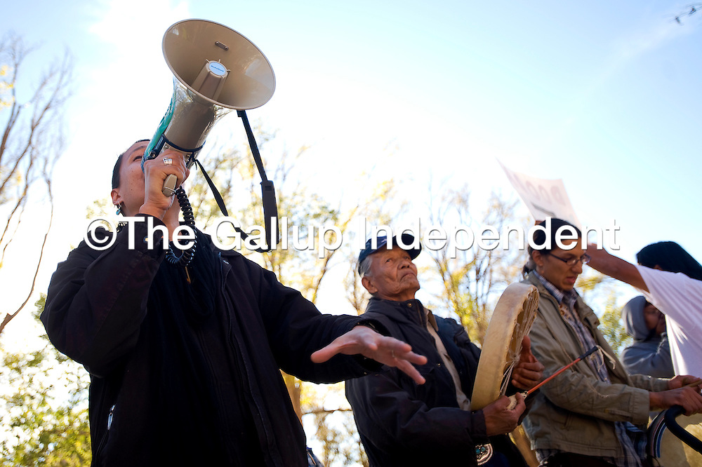 110410      Brian Leddy<br /> Klee Benally addresses a crowd of protesters at the Navajo Nation Council Chamber on Thursday morning. About 100 marchers showed up to protest the Arizona Water Right Settlement that the council is considering.