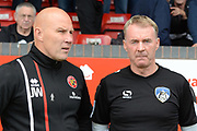 Walsall manager Jon Whitney and Oldham Athletic manager John Sheridan talk to each other during the EFL Sky Bet League 1 match between Walsall and Oldham Athletic at the Banks's Stadium, Walsall, England on 12 August 2017. Photo by Alan Franklin.