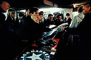A group of young people watch a DJ perform, Black Market record shop, London 1998.