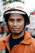 Firefighter look tired after succeed extinguish the fire. On March 9th 2015 wisma kosgoro hit by fire, total 5 floor destroyed. Total 38 fire ambulance car sent to extinguish the fire. No victim caused by the fire, only material lost that cost million of rupiah.