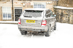 Pictured: Even 4X4s get stuck in the snow<br /> <br /> The beast from the east was tackled in different ways in Edinburgh today with some taking refuge in the West Room while others struggled against the snow.<br /> Ger Harley | EEm 28 February 2018