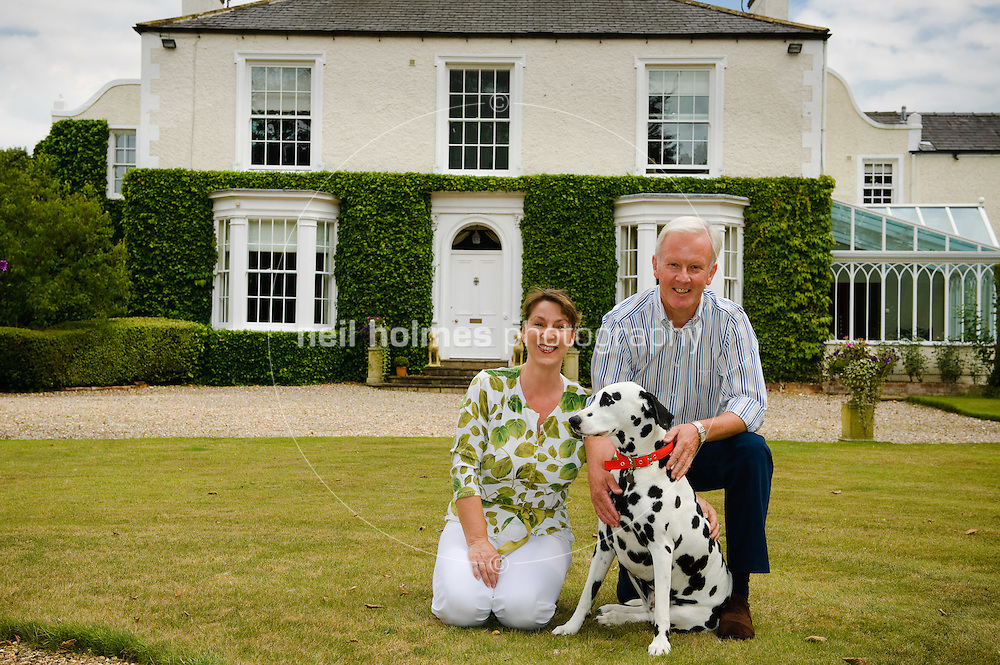Kilham Hall hotel, Kilham village East Yorkshire, pictured owners Joanne Long, David Berry and their dog Willow.