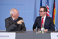 "16 MAR 2017, BERLIN/GERMANY:<br /> Wolfgang Schaeuble (L), CDU, Bundesfinanzminister, und Steven Terner ""Steve"" Mnuchin (R), Fianzminister der Vereinigten Staaten von Amerika, USA, im Gespraech, nach einer Pressekonferenz nach einem gemeinsamen Treffen, Bundesministerium der Finanzen<br /> IMAGE: 20170316-03-030<br /> KEYWORDS: Wolfgang Schäuble, Steve Mnuchin, Treasury secretary, Gespräch"