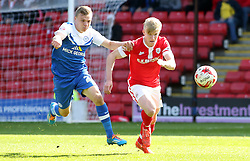 Peterborough United's Harry Anderson in action with Barnsley's George Smith - Photo mandatory by-line: Joe Dent/JMP - Mobile: 07966 386802 - 18/04/2015 - SPORT - Football - Barnsley - Oakwell - Barnsley v Peterborough United - Sky Bet League One