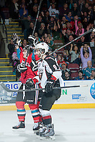 KELOWNA, CANADA - MARCH 15: Carter Rigby #11 of the Kelowna Rockets celebrates his second goal against the Vancouver Giants on March 15, 2014 at Prospera Place in Kelowna, British Columbia, Canada.   (Photo by Marissa Baecker/Getty Images)  *** Local Caption *** Carter Rigby;