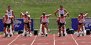 Decathlon athletes (L-R) Johannes Schwuchow of Germany, Chris Boyles of the United States, Maren Schwerdtner of Germany, Chris Randolph of the United States and Marian Geisler of Germany, take off out of the blocks in 100-meter dash at the Nike Combined Events Challenge at the R.V. Christian Track Complex on the campus of Kansas State University in Manhattan, Kansas, August 5, 2006.
