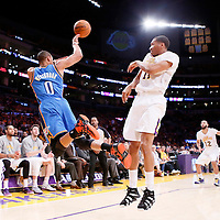 09 March 2014: Oklahoma City Thunder point guard Russell Westbrook (0) saves the ball in front of the Los Angeles Lakers bench and Los Angeles Lakers small forward Wesley Johnson (11) during the Los Angeles Lakers 114-110 victory over the Oklahoma City Thunder at the Staples Center, Los Angeles, California, USA.