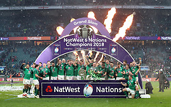 File photo dated 17-03-2018 of The Ireland team celebrate with their trophy after winning the grand slam during the NatWest 6 Nations match at Twickenham Stadium, London.