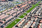 Nederland, Noord-Holland, Zaanstad, 20-04-2015; Noordpolder met de nieuwe woonwijk Saendelft, tussen Assendelft en Krommenie. De groenstrook heet Weideland.<br /> Newly developed residential area, Zaanstad. <br /> luchtfoto (toeslag op standard tarieven);<br /> aerial photo (additional fee required);<br /> copyright foto/photo Siebe Swart