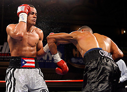 June 20, 2007; New York, NY, USA;  Edgar Santana (l) and Harrison Cuello (r) trade punches during their 10 round junior welterweight main event at the Grand Ballroom at the Manhattan Center in New York, NY.  Cuello shocked the favored Santana by 3rd round KO.