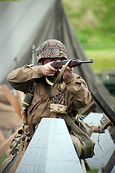 Reenactor portraying a member of the US airborne takes part in a battle reenactment at Fort Paull Monday 7  May 2012.Image © Paul David Drabble