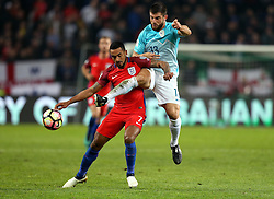 Began Jokic of Slovenia tackles Theo Walcott of England - Mandatory by-line: Robbie Stephenson/JMP - 11/10/2016 - FOOTBALL - RSC Stozice - Ljubljana, England - Slovenia v England - World Cup European Qualifier