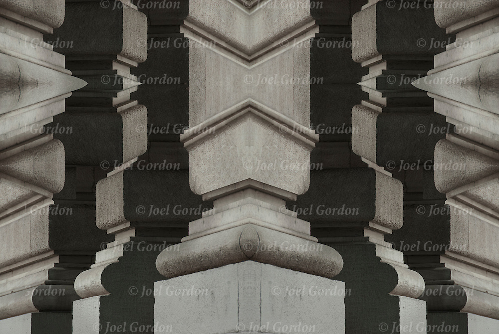 Looking at corner of building with mirror repeating shapes and patterns on facade sides illusion.<br />