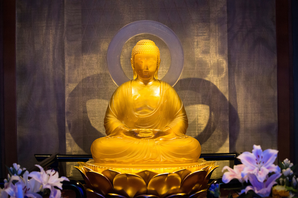 TOKYO, JAPAN - JULY 7 : A Buddha altar inside the Koukokuji temple on July 7, 2016 in Tokyo, Japan. Operated by the Koukokuji buddhist temple, The Ruriden columbarium at the Koukoko-ji Temple houses over 2,046 crystal Buddha statues, each illuminated by high-powered LED lights. Behind each Buddha is a drawer storing people's ashes. An IC card allows the owner of the alter to access the building and lights up the corresponding statue. The ashes are stored for 33 years before being buried below the Ruriden, currently 900 alters are in use as of July 2016. (Photo: Richard Atrero de Guzman/NUR Photo)