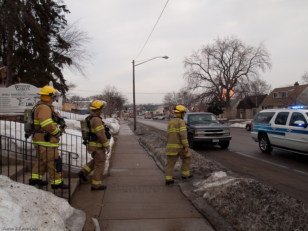 firefighters go door to door expanding the evacuation zone as the natural gas fire burned on in South Minneapolis
