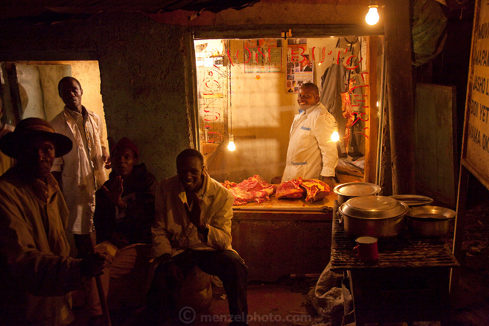 A butcher prepares meat for sale at a butchery in the Kibera slum, Africa's largest slum settlement with nearly one million inhabitants.
