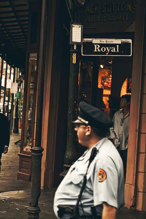 Police officer walks beat in French Quarter of New Orleans, LA.  Copyright 2011 Reid McNally