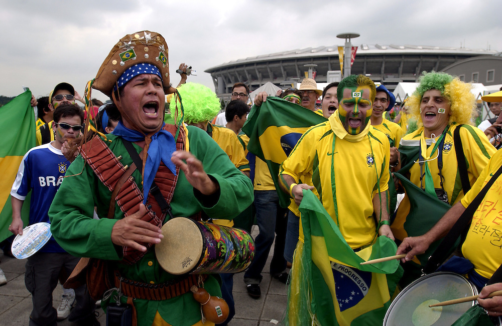 Brazilian football supporters entertain the crowd with plenty of Samba outside the Yokohama Stadium the day of the World Cup Final between Germany and Brazil. 30/06/02..©David Dare Parker/AsiaWorks Photography