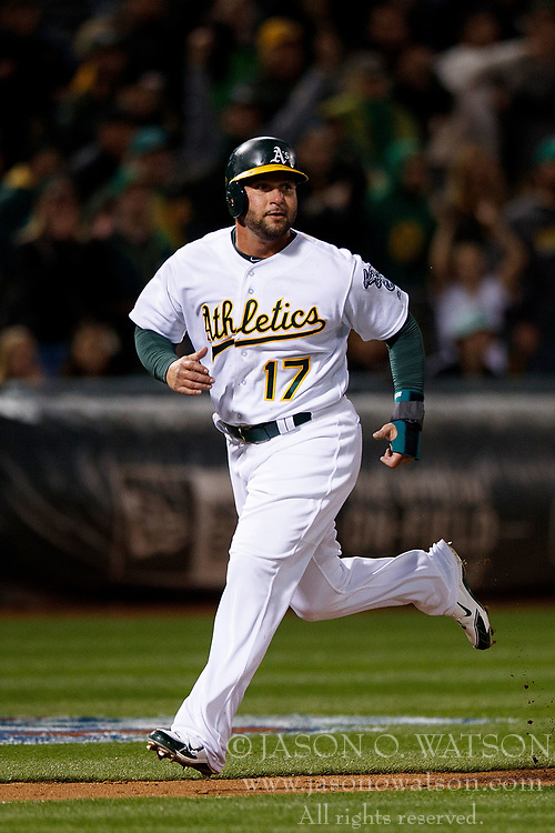 OAKLAND, CA - APRIL 04:  Yonder Alonso #17 of the Oakland Athletics scores a run against the Los Angeles Angels of Anaheim during the seventh inning at the Oakland Coliseum on April 4, 2017 in Oakland, California. The Los Angeles Angels of Anaheim defeated the Oakland Athletics 7-6. (Photo by Jason O. Watson/Getty Images) *** Local Caption *** Yonder Alonso