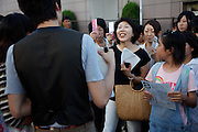 Tokyo, September 18 2011 - Japanese girls and ladies asking for autographs and taking pictures of two Korean musicians. Korean mania reached Tokyo's Korean neighborhood near Shinokubo station. For a long time Japanese ladies in their 50ies have been interested in Korean televised dramas. Recently the success of K-Pop (Korean popular music) in Japan has brought a younger population in the neighborhood.