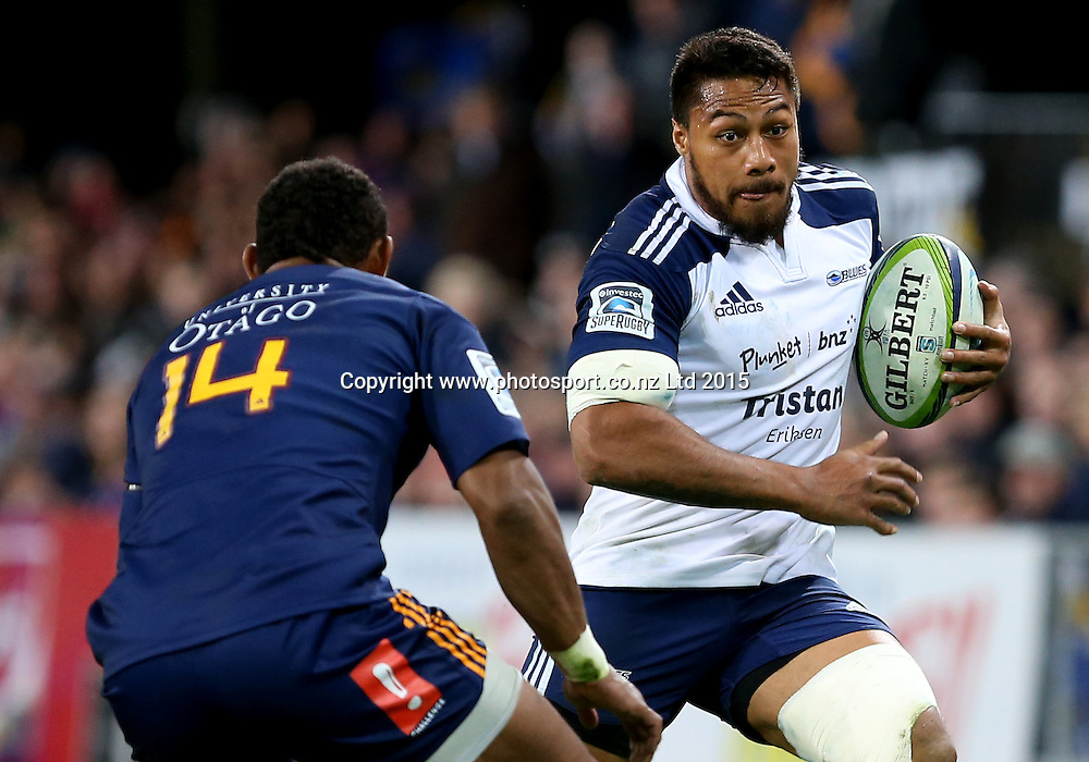 Blues George Moala, right, is challenged by Highlanders Waisake Naholo during the Super 15 rugby match between the Highlanders and the Blues at Forsyth Barr Stadium, Dunedin, Saturday, April 18, 2015. Photo: Dianne Manson / www.photosport.co.nz