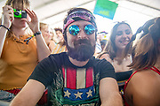 A young man enjoys the music during The Grand Ole Oprys set at The Bonnaroo Music and Arts Festival