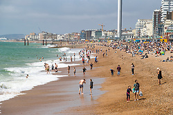 © Licensed to London News Pictures. 01/08/2020. Brighton, UK. Members of the public take to the beach in Brighton And Hove as sunny weather hits the seaside resort. Photo credit: Hugo Michiels/LNP