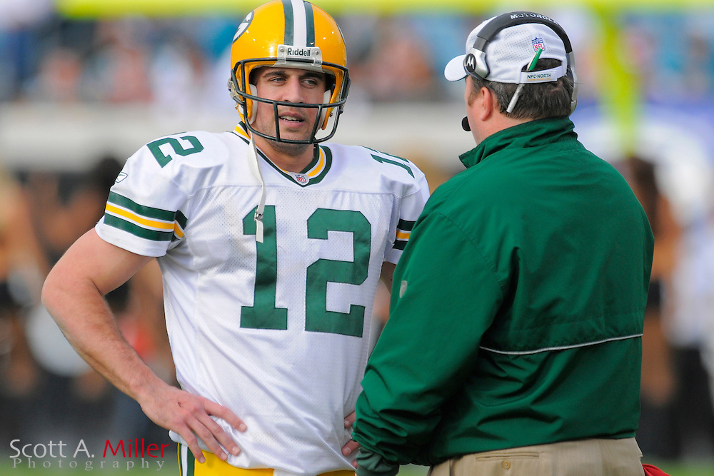 Jacksonville, FL. -- Green Bay Packers quarterback Aaron Rodgers (12) and coach Mike McCarthy during the Packers game against the Jacksonville Jaguars on Dec. 14, 2008 at Jacksonville Municipal Stadium....©2008 Scott A. Miller