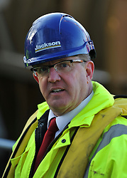 © Licensed to London News Pictures. 20/12/2011, Windsor, UK. DAVID DeCHAMBEAU, Director of Southeast Power Engineering LTD (SEPEL). One of the two giant 40 tonne Archimedes screws is lifted into place at Romney Weir on the River Thames. The screws, the largest in the UK and fish friendly, will generate 300 kilowatts of energy every hour to power Windsor Castle. It is the largest hydropower scheme in the South East of England. Photo credit: Stephen Simpson/LNP
