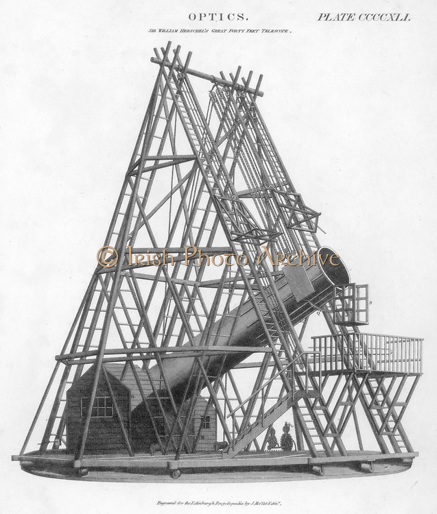 Reflecting telescope of 40 ft/12 m focal length, 1789.  Built by William Herschel (1738-1822) the German-born English astronomer, this instrument was the largest in the world, had a 4 ft/1.2 m mirror.  Herschel made observations with this telescope but made more use of a smaller 18 in/46 cm instrument.  From 'The Edinburgh Encyclopaedia'. (Edinburgh, 1807-1829). Engraving.