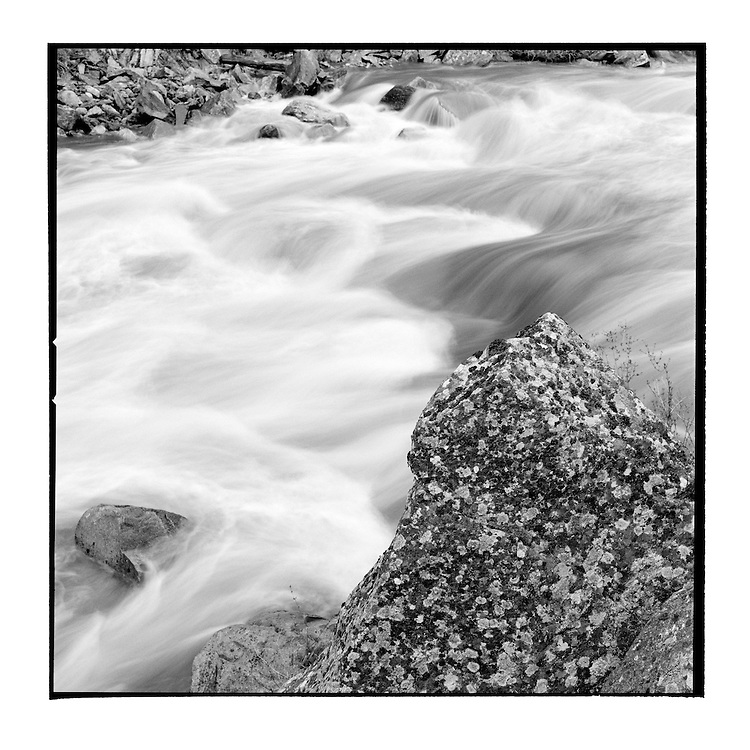 USA, Idaho, Pinehurst, Blurred water in rapids along Salmon River at sunset on spring evening