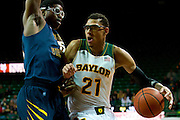 WACO, TX - JANUARY 28: Isaiah Austin #21 of the Baylor Bears drives to the basket against the West Virginia Mountaineers on January 28, 2014 at the Ferrell Center in Waco, Texas.  (Photo by Cooper Neill/Getty Images) *** Local Caption *** Isaiah Austin