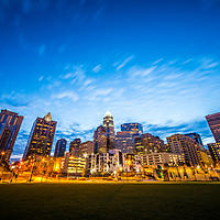 Charlotte skyline at dusk with Romare Bearden Park, downtown Charlotte city buildings, and a beautiful blue sky. Charlotte. North Carolina is a major city in the Eastern United States of America.