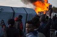 Calais, Pas-de-Calais, France - 25.10.2016    <br />  <br /> In the time after the beginning of the camp destruction numerous fires were placed in the camp. 2nd day of the eviction on the so called &rdquo;Jungle&quot; refugee camp on the outskirts of the French city of Calais. Many thousands of migrants and refugees are waiting in some cases for years in the port city in the hope of being able to cross the English Channel to Britain. French authorities announced a week ago that they will evict the camp where currently up to up to 10,000 people live.<br /> <br /> In der Zeit nach dem beginn der Camp zerst&ouml;rung wurden zahlreiche Feuer im Camp gelegt. Zweiter Tag der Raeumung des so genannte &rdquo;Jungle&rdquo;-Fluechtlingscamp in der franz&ouml;sischen Hafenstadt Calais. Viele tausend Migranten und Fluechtlinge harren teilweise seit Jahren in der Hafenstadt aus in der Hoffnung den Aermelkanal nach Gro&szlig;britannien ueberqueren zu koennen. Die franzoesischen Behoerden kuendigten vor einigen Wochen an, dass sie das Camp, indem derzeit bis zu bis zu 10.000 Menschen leben raeumen werden. <br /> <br /> Photo: Bjoern Kietzmann
