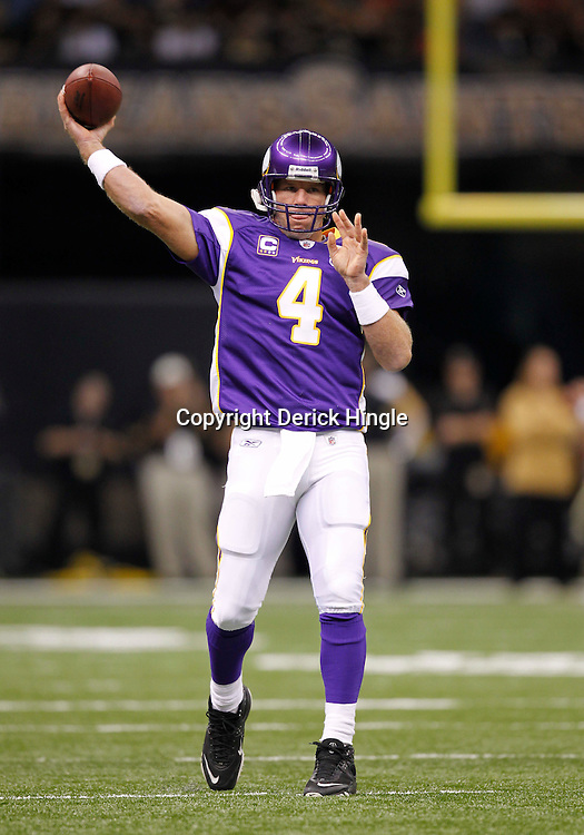 September 9, 2010; New Orleans, LA, USA;  Minnesota Vikings quarterback Brett Favre (4) during warm ups prior to the NFL Kickoff season opener between the Minnesota Vikings and the New Orleans Saints at the Louisiana Superdome. Mandatory Credit: Derick E. Hingle