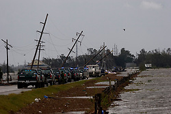 24 Sept 2005.  Louisiana/Texas border. Hurricane Rita aftermath. <br /> Route 27, Louisiana where the storm hit hardest on the Louisiana/Texas border. The back edge of Rita floods across the roadway as rescue workers attempt to reach stranded flood victims.<br /> Photo; ©Charlie Varley/varleypix.com
