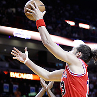 06 March 2011: Chicago Bulls center Joakim Noah (13) goes for the layup during the Chicago Bulls 87-86 victory over the Miami Heat at the AmericanAirlines Arena, Miami, Florida, USA.