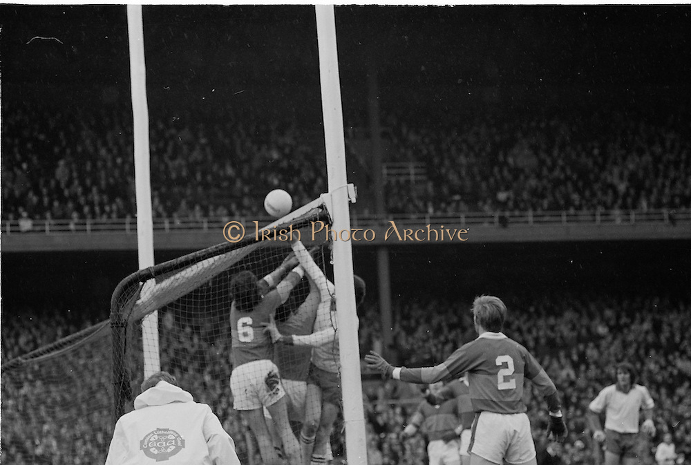 Tyrone places the ball over the bar despite the best efforts made by the Kerry goalie and players to stop him during the All Ireland Minor Gaelic Football Final, Tyrone v Kerry in Croke Park on the 28th September 1975.