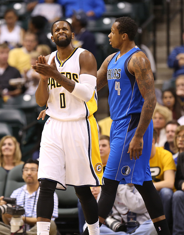 Indiana Pacers' C.J. Miles reacts after fouling Dallas Mavericks' Greg Smith in the first half of the game at Bankers Life Fieldhouse Saturday October 18, 2014.