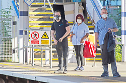 ©Licensed to London News Pictures 15/06/2020<br /> Petts Wood, UK. Commuters wearing protective masks at Petts Wood train station Petts Wood, South East London. It is now compulsory to wear a face covering or masks on public transport in the UK due to the Coronavirus outbreak. Photo credit: Grant Falvey/LNP