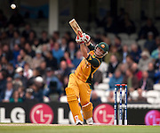 David Warner bats during the ICC World Twenty20 Cup match between Australia and West Indies at the Oval. Photo © Graham Morris (Tel: +44(0)20 8969 4192 Email: sales@cricketpix.com)